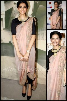 @SonamAKapoor in an Anamika Khanna number that's a cross between a #Saree and a Dress...love the light pink color of the Palu and its intricate embroidery and  black edging. The winning edge of this outfit is the stunning Kundan Jewelry necklace.