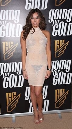 Nearly nude: Model Pascal Craymer left little the imagination in a bodycon dress with strange, strategically-placed silver panels as she attended the Going For Gold launch party in London on Tuesday night