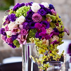 An intimate Cabo San Lucas wedding with vibrant purple and green florals and a unique table setup!