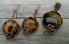 Check out this item in my Etsy shop https://www.etsy.com/listing/228231497/tiger-eye-signature-pendant-and-earring