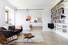 Mooie woonkamer met grote schuifdeur