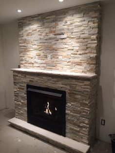 California Gold Ledger Stone accent wall and fireplace surround ...