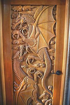 Carved wood dragon door