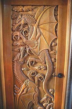 Carved wood dragon door