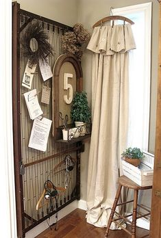 "Tutorial: drop cloth ""curtain"" on a vintage hanger.  Look at the bed spring-thingy, too!"