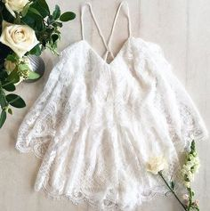 Flatlay of the alice McCALL Lucy In The Sky Playsuit styled by Coco & Lola