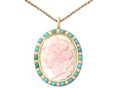Angel Skin Coral, Turquoise and Seed Pearl, 15 ct Yellow Gold Cameo Pendant  SKU: A3935 Price  GBP £1,695.00  http://www.acsilver.co.uk/shop/pc/Angel-Skin-Coral-Turquoise-and-Seed-Pearl-15-ct-Yellow-Gold-Cameo-Pendant-171p7861.htm#.VkIABL88rfc