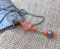 A personal favorite from my Etsy shop https://www.etsy.com/listing/506299763/orange-beauty-lampwork-bead-with-orange