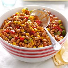 Barbecued Bean Salad Recipe...This tangy, hearty salad is a refreshing dish to serve at a summertime picnic. Mild spices blend nicely with the beans and garden ingredients. Be prepared to bring home an empty bowl.