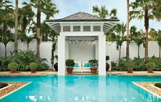 At one end of the T-shaped pool is a hip-roofed pavilion | archdigest.com