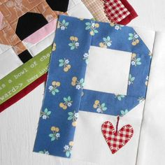 Block 115 - Spelling Bee Uppercase P - for the Patchsmith of course!  (The gingham heart gave it away didn't it?)