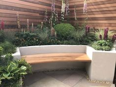 Rendered raised bed with built-in seat. Designer: Jo McCreadie. Image:  Lorraine Young /Verve Garden Design.