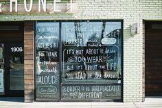 Custom hand-drawn lettering on windows for Milk & Honey boutique
