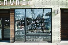 Custom hand-drawn lettering on windows for Milk & Honey boutique