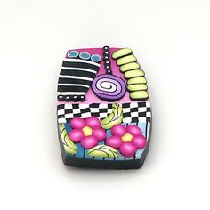 Colorful Lapel Pin by Alice Stroppel, polymer clay.