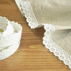 self- adhesive fabric tape.... a lightbulb just went off over my head! All this time, I've been trying to figure out how to attach lace to things without sewing them by hand! *ding ding*