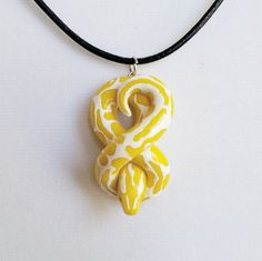 Banana Ball Python Necklace. Handmade, Polymer Clay Reptile Pendant, Crafted by The Clay Kiosk on Etsy. Fimo Clay, Polymer Clay Jewelry, Polymer Clay Charms, Polymer Clay Creations, Polymer Clay Projects, Polymer Clay Art, Clay Crafts, Ball Python, Biscuit