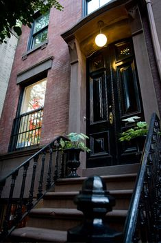 Classic new York brownstone. love the black lacquered doors