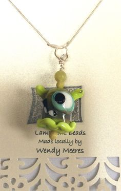 A personal favorite from my Etsy shop https://www.etsy.com/ca/listing/522409073/monster-lampwork-pendant