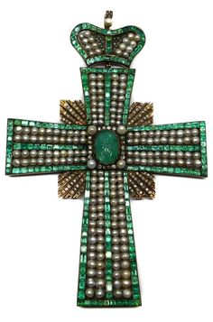 Large 19th century emerald, pearl and diamond cross pendant with coronet surmount, Russian c.1850 via The straight tapered arms set with lines of rectangular cut emeralds, filled with double rows of pearls, centred by a carved oval cabochon emerald, a square of radiating diamond lines to the middle between the arms, from a hinged similarly