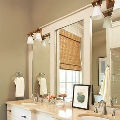 "If you have one of those gigantic builder mirrors over your bathroom vanity, don't rip it out!   Simply trim it out with inexpensive wood painted to match your decor.  I have seen this done ""framing"" the mirror, but never down the center."
