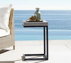 small side table option (meant for outdoors but is a great indoor option as well- this also has some weight to it- so it would be a great option to not fall down, as your daughter learns to mobilize more) Sloan Concrete C-Table #potterybarn