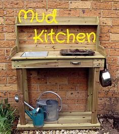 Post image for Our Play Space: A Mud Play Kitchen From a Potting Table