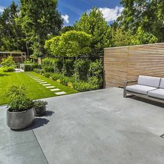 Stunning Contemporary Garden, A generous polished concrete patio continues from inside to outside and steps down to sawn sandstone paving stones Garden Paving, Concrete Garden, Concrete Patios, Garden Slabs, Concrete Patio Designs, Pavers Patio, Patio Stone, Patio Fence, Stone Path