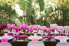 pink ombre flowers and place setting. Use Fuchsia, Light guava and blush napkins at www.cvlinens.com