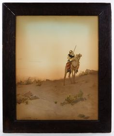 Lot 625: R. Talbor Kelly (20th Century) Enhanced Print; 1902, printed signature lower left, depicting a male riding a camel in the sand
