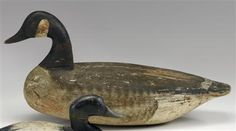 CARVED AND PAINTED CANADA GOOSE DECOY, ATTRIBUTED TO IRA HUDSON (1873-1949) CHINCOTEAGUE, VA, 1ST QUARTER 20TH CENTURY, WITH TACK EYES.