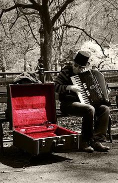 Accordion player in the park.