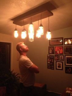 good step by step on how to make a mason jar chandelier... this will be above my sink!
