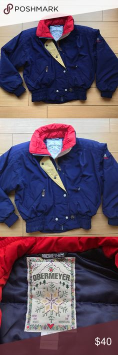 """Retro Obermeyer Ski Winter Snow Puffer Jacket Size 6 women's. """"Anita"""" style. Color is dark blue, with red and golden yellow accent colors. Obermeyer patch on inside. Full zipper closure with over flap. Snap closure on over flap. Two zipper exterior waist pockets. One interior zipper on left breast pocket. EUC - no visible flaws. Very warm and insulated! Perfect for all your winter snow activities! Obermeyer Jackets & Coats Puffers"""