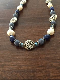 A personal favorite from my Etsy shop https://www.etsy.com/listing/516226447/blue-coral-pearl-and-lapis-necklace