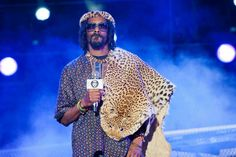 Scum Dog!! Snoop spotted wearing a dead leopard at his concert in Durban back in may Image courtesy of Moses Mabida Stadium, SA