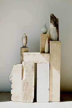 No info on this either, but love the vases and raw limestone(?), marble (?).