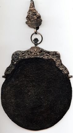 Antique, circular beaded black purse. Etsy from JennySparrow.