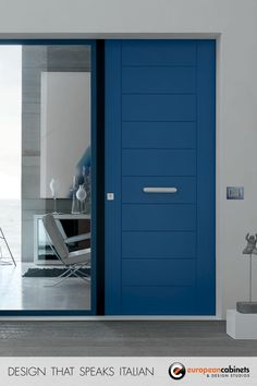 Modern blue front door from the Oikos Evolution collection. Available in a huge variety of colors, sizes, and finishes.