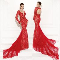"This Tarik Ediz style 92502 "" SIMAL"" is definitely a gown that will turn heads. Draped with beautiful red lace this gown showcases a sexy plunging neckline. A fitted silhouette hugs the waist and flows into a breathtaking train. Accessorize this dress with red chandelier earrings. This 2015 Tarik Ediz style is perfect to wear to prom or an engagement. Available in Red color , size -36 ,price R 8 808 SEE MORE -http://www.bridalallure.co.za/e…/tarik-ediz-2015/92502-simal tel. +27(0) 215564880"