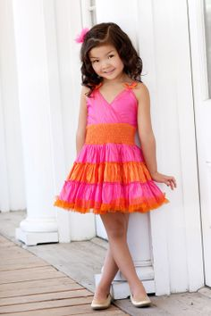 Ooh! La, La! Couture NEW Holiday/Cruise 2013 Collection     Precious sundress in sherbet colors.     Three tiered skirt with smocked, satin waistband and tiny bows at the straps.     Large bow in the back.
