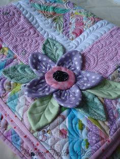 The Nifty Stitcher  Look at this flower for an alternate approach to flowers for C. D.'s shawl...