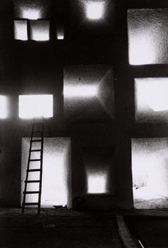 Le corbusier's Notre dame du haut in ronchamp, photographed by Rene Burri (1955) the light speaks through the concrete.
