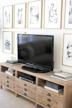 Framed minted art arranged in a grid surrounding the tv console from wisteria pictures from minted Family Room Design, Dresser With Tv, Awesome Bedrooms, Tv Unit Furniture, Tv Console Decorating, Tv In Bedroom, Trendy Living Rooms, Room Design, Living Room Art