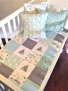 Indian summer range is here.. It is made up of a top panel featuring a patchwork design featuring a mix of prints. The quilt measures approx 88cm x 115cm.. This quilt has 100% natural cotton batting which is a breathable fibre which can absorb moisture away from your baby.