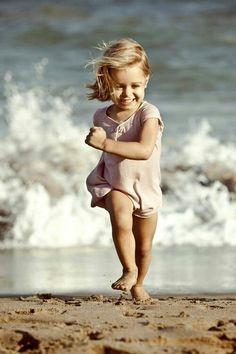 Baby girl on the beach Toddler girl running