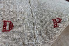 antique hemp linen used as bedspread