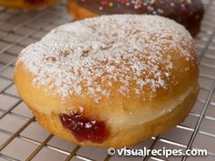 Learn how to make donuts with step by step pictures. Pictured is a delicious raspberry jelly filled donut. Learn how to make vanilla and chocolate glazed as well.