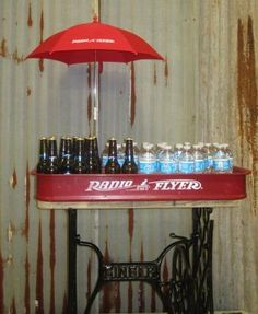 Vintage Party Bar made from Singer Sewing Machine base, Radio Flyer Red Wagon and Radio Flyer umbrella.  Just add ice, your favorite beverages and roll it out for your next party.  You friends and family will have surprised looks on their faces - have a camera ready and get ready to party!
