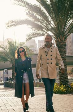 Artists Sara Naim and Athier Mousawi outside Dubai Marina wearing Burberry trench coats for  Art of the Trench Middle East
